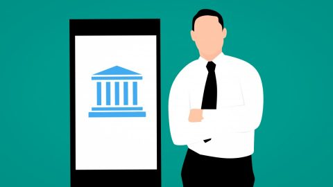 Illustrated image of a bank employee standing next to a digital device